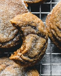 These Soft & Chewy Molasses Cookies are a year-round classic that deserve special attention at Christmas time.  Mildly spiced, richly flavored from the molasses and brown sugar, and generously sprinkled with granulated sugar for a touch of sparkle, this classic molasses cookie recipe belongs in your dessert arsenal.