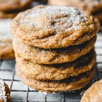 stacked molasses cookies on a wire rack