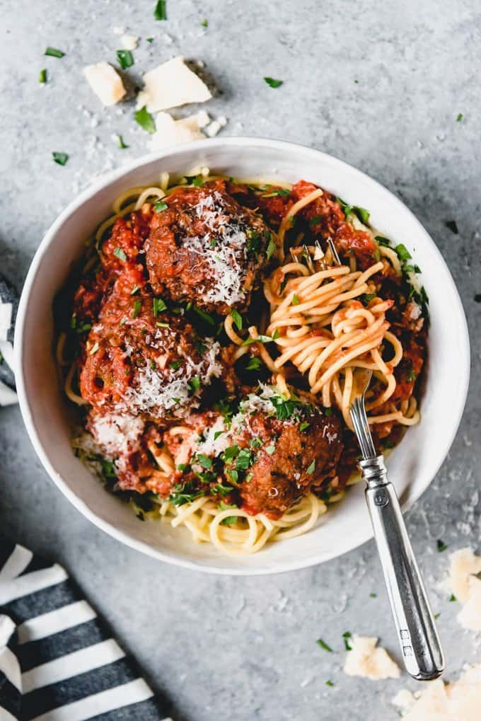 An image of deep fried Italian meatballs in a rich tomato sauce over al dente pasta is classic Italian-American cuisine that everybody loves.