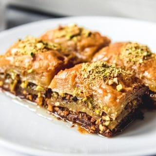 Turkish Baklava, also known as Fistikli Baklava or Pistachio Baklava is a deliciously rich, buttery, sweet dessert made from phyllo dough, finely ground pistachios, butter, and a syrup made from sugar, water and lemon juice.  That's it!