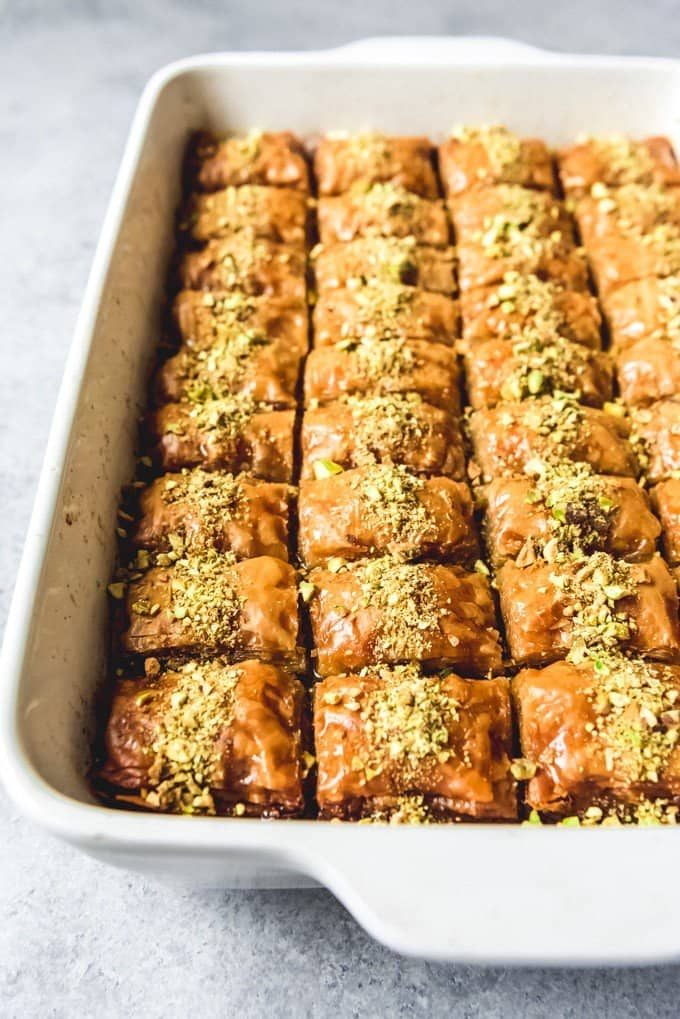An image of a pan full of authentic Turkish baklava made with pistachios and no honey.