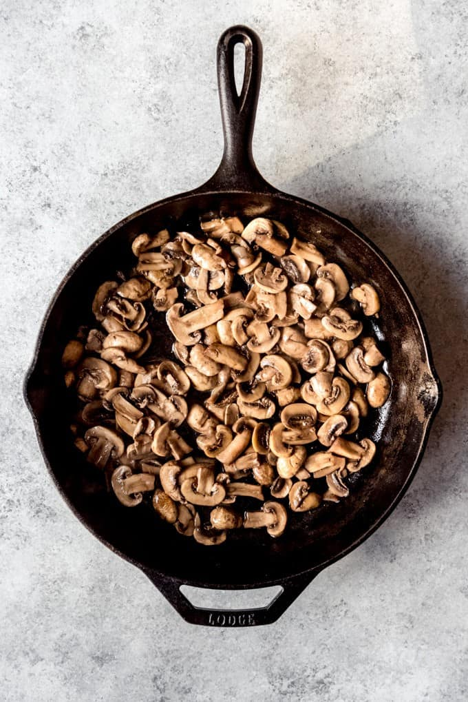 An image of a pan full of sauteed mushrooms.