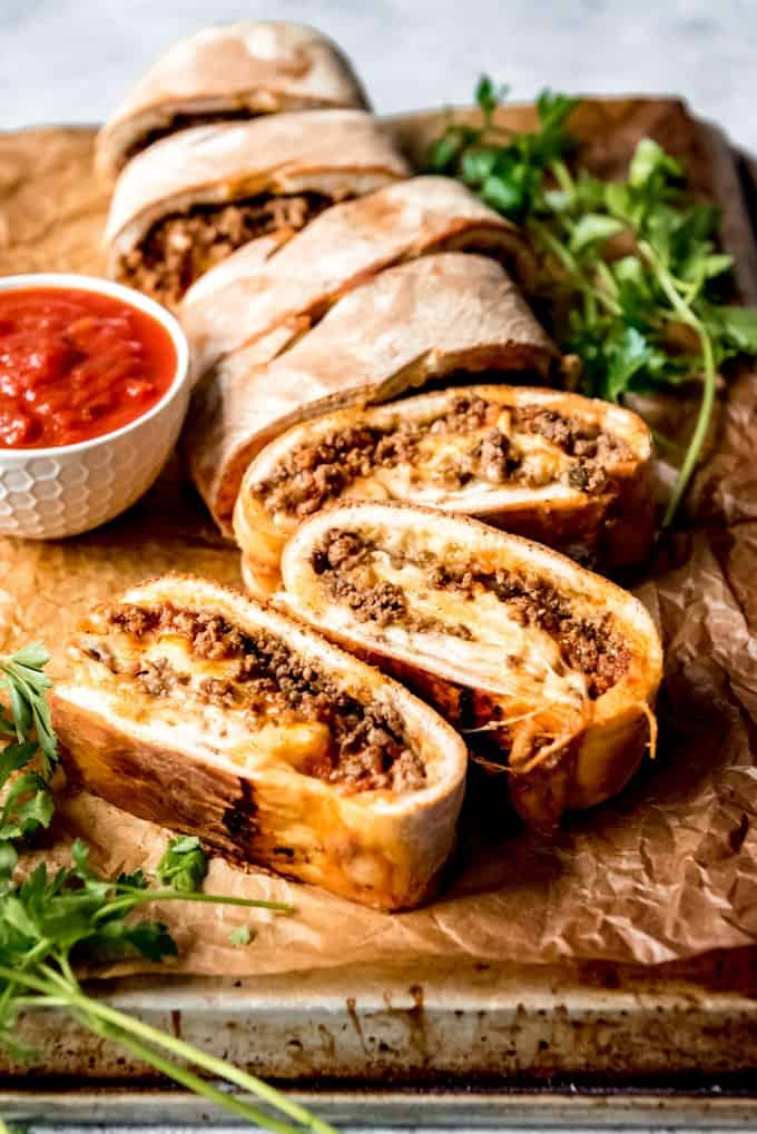 An easy stromboli recipe that is easy to make and filled with delicious savory fillings like ground beef and cheese.