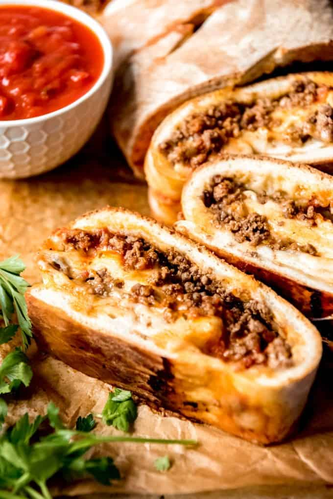 A homemade stromboli recipe that is easy to make and filled with delicious savory ground beef and cheese.