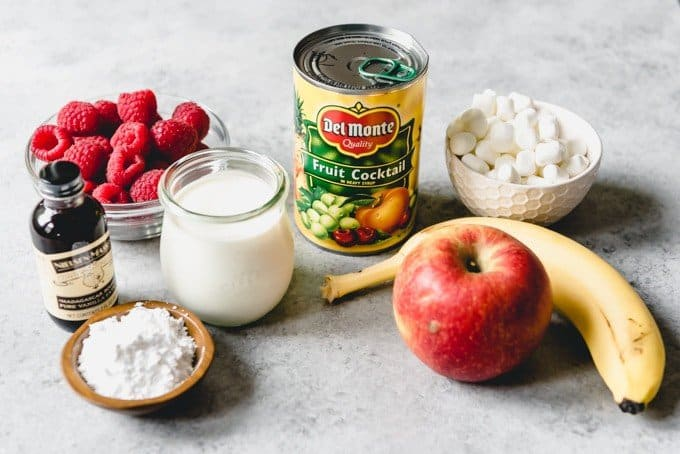 An image of a can of fruit cocktail with the other ingredients for making fruit salad with whipped cream and marshmallows.