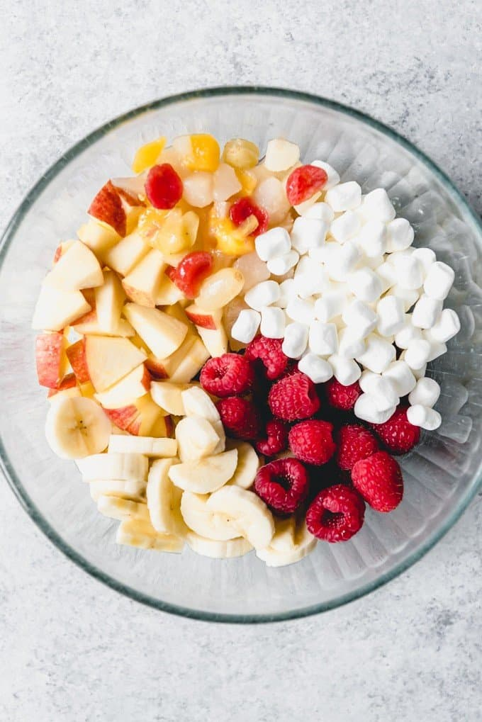 An image of a bowl of chopped fruit with marshmallows for making a fresh fruit salad.
