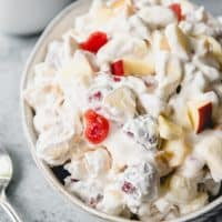 a bowl of fruit salad with whipped cream
