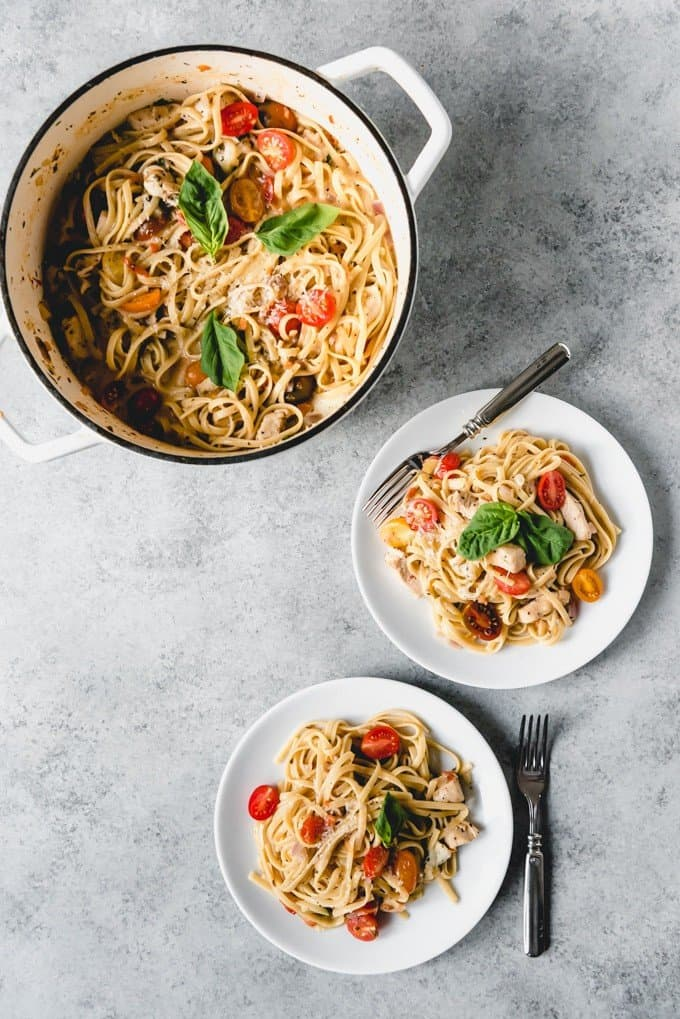 An image of an easy one pot meal recipe for creamy bruschetta chicken pasta.