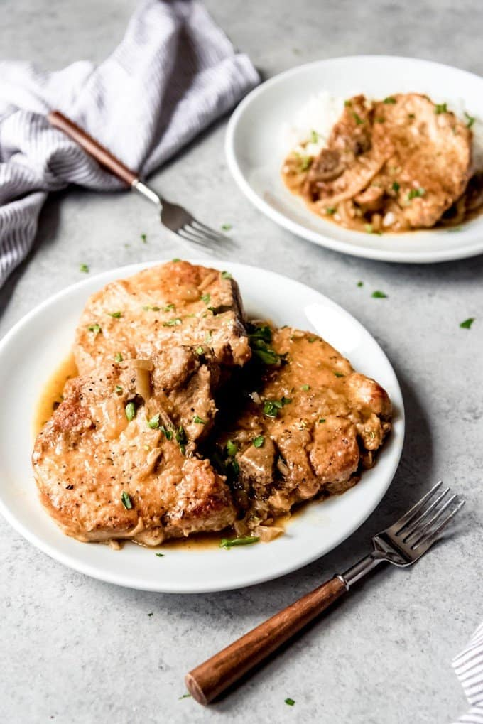 This easy Smothered Pork Chops Recipe is a Southern classic and true soul food that always satisfies.  The velvety, savory gravy and tender, juicy pork chops go so well together and are as perfect for weeknight cooking as they are for Sunday supper.