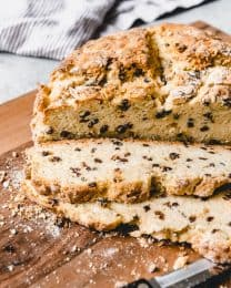 A traditional Irish soda bread recipe has only four ingredients - flour, baking soda, buttermilk, and salt.  My favorite Irish Soda Bread recipe is a slightly updated version of the classic, with a little sugar, butter, an egg, and currants or raisins added to it for improved texture and flavor.  It's absolutely delicious served warm with fresh Irish butter slathered on each slice.