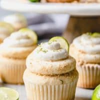 key lime cupcakes garnishes with crumbs and key lime slices