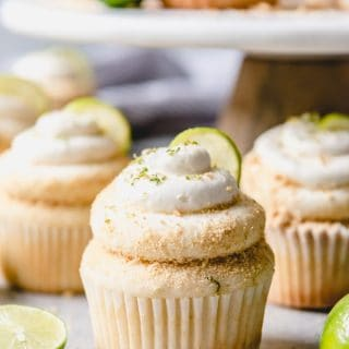 Take a tropical vacation with these Key Lime Cupcakes topped with a key lime buttercream and graham cracker crumbs!
