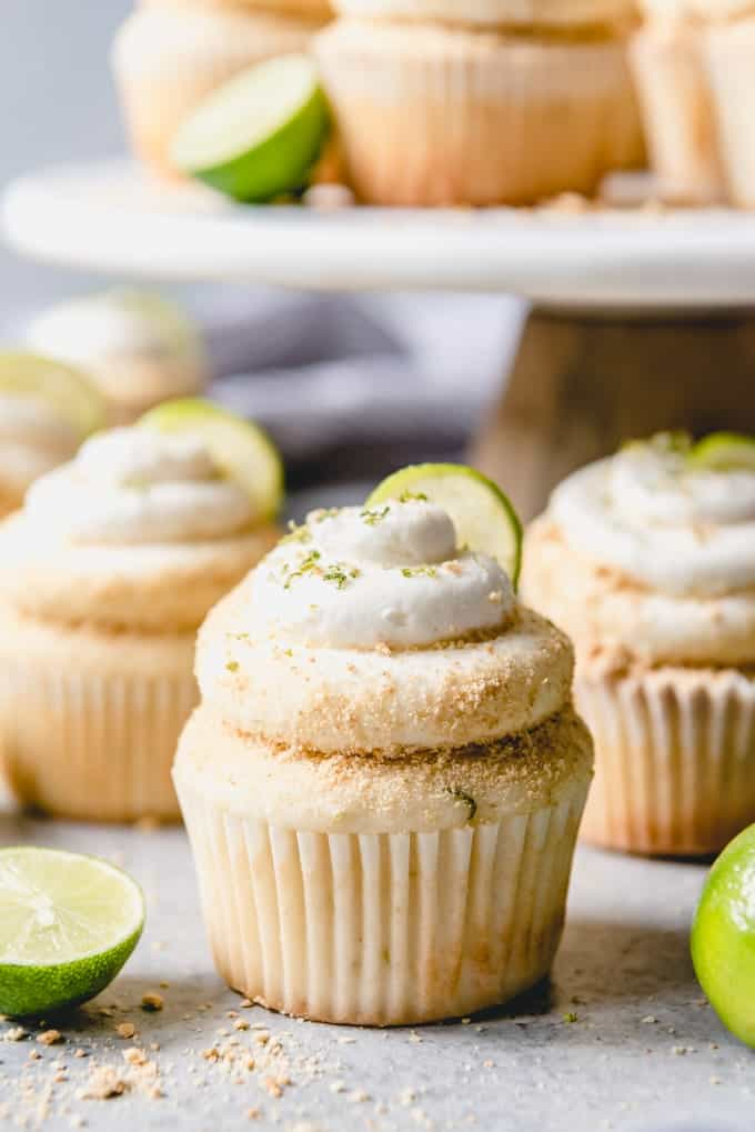 Take a tropical vacation with these delicious and moist Key Lime Cupcakes topped with a key lime buttercream frosting and graham cracker crumbs!