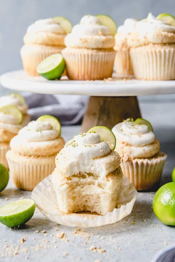 An image of a moist lime cupcake with a bite taken out of it.