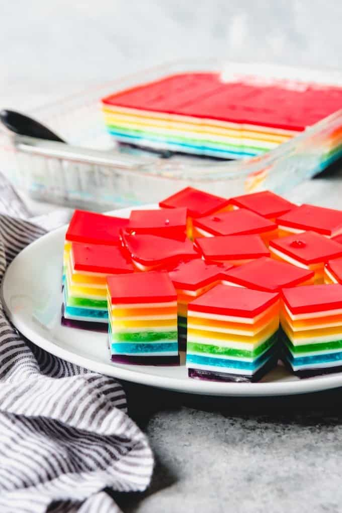 An image of rainbow jello jigglers cut into cubes for easy eating.