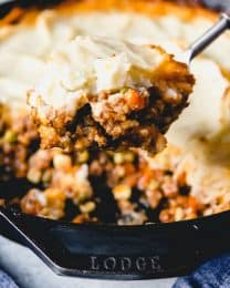 a close up view of a spoonful of sheperds pie