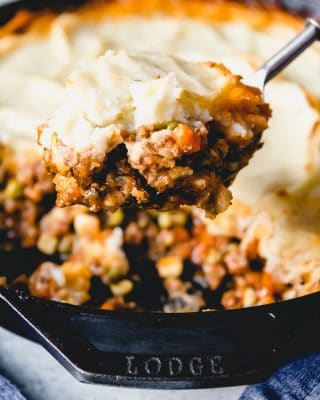 A rich gravy with lamb and vegetables hidden under creamy mashed potatoes make this the BEST Shepherd's Pie recipe.  Ever.  Okay, in my opinion.  But I'm pretty confident about this Irish comfort food classic.