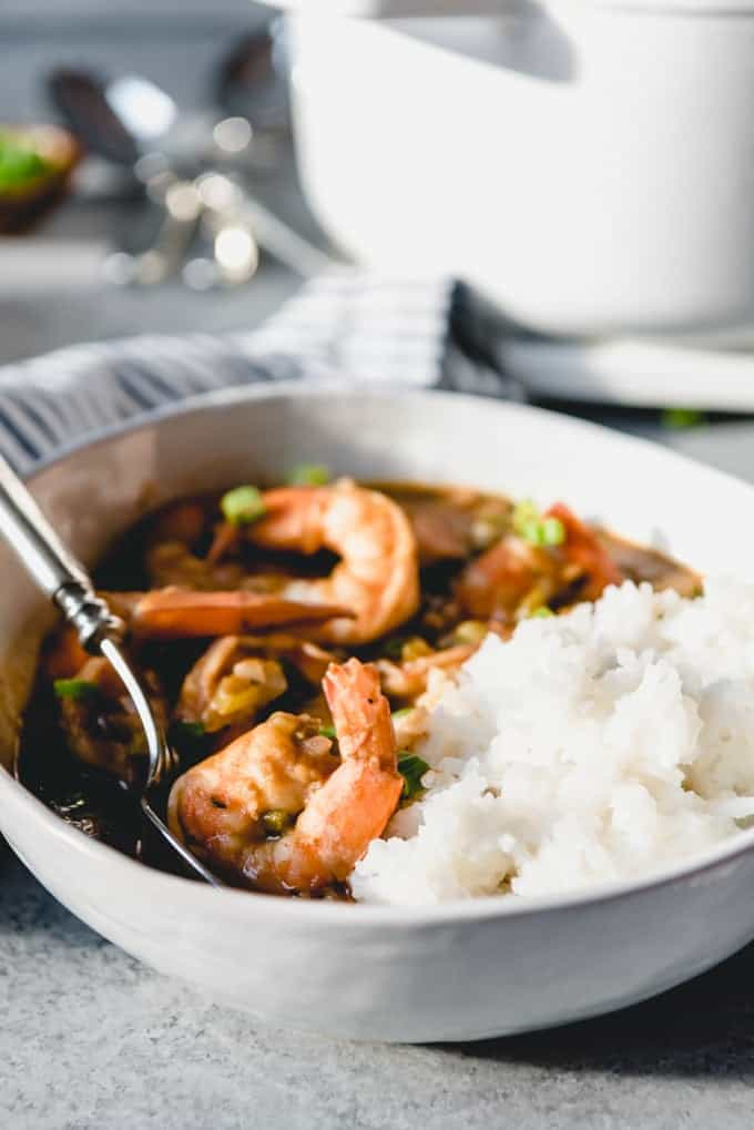 An image of a bowl of Cajun shrimp etouffee with white rice.