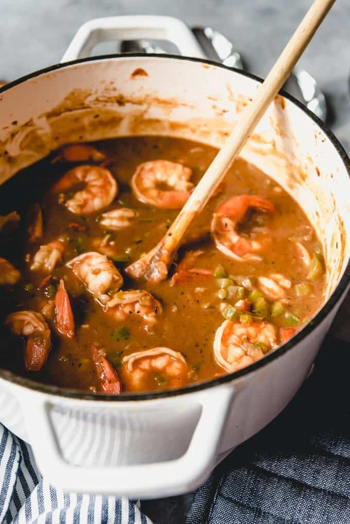 A dutch oven full of Cajun shrimp etouffee.