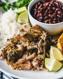 Tender, Slow Cooker Cuban Mojo Pork is full of garlic and citrus flavors.  It's a simple dump-and-go recipe that marinates in a Cuban mojo sauce in the crock pot.  And the leftovers make the best Cuban sandwiches ever!