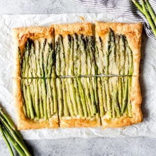 Delicious tender-crisp asparagus on a flaky, buttery puff pastry crust with plenty of cheese and Dijon mustard, this easy Asparagus Tart is casually elegant and perfect for brunches, Mother's Day, showers & parties, and more.