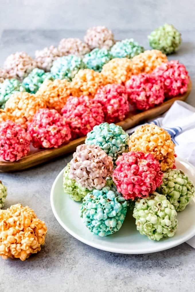 An image of Spring popcorn balls in bright rainbow colors for a fun, festive treat for Easter.