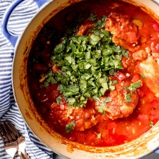This Georgian Chicken Stew with Tomatoes and Herbs [Chakhokhbili] is an easy, traditional dish from the country of Georgia.  This one pot meal consists of seared chicken pieces cooked in a bright, comforting tomato sauce that is delicious over rice or with fresh garlic naan bread for sopping juices.