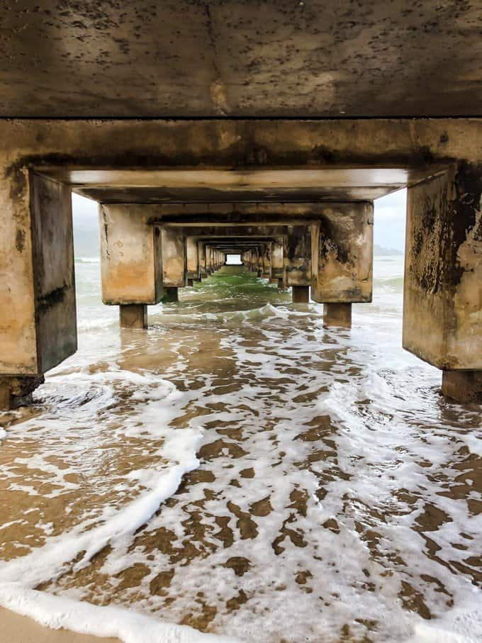 under a walkway bridge at the beach