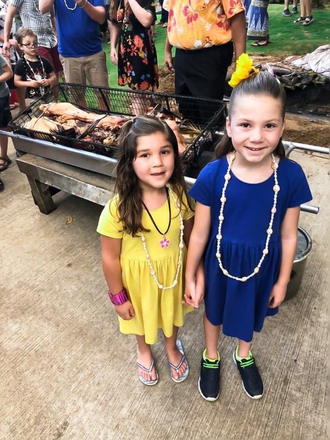 two girls standing near a cart