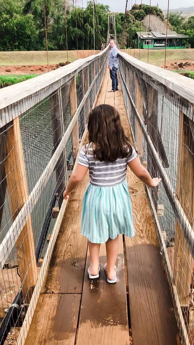 a girl on a narrow bridge