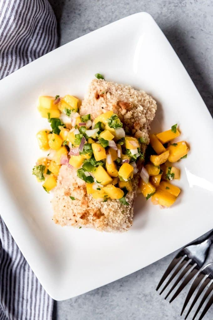 An image of a macadamia nut crusted mahi-mahi fillet topped with mango salsa.