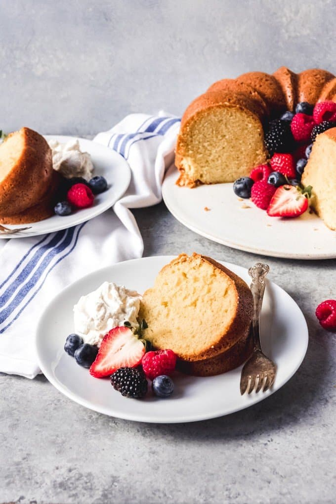 This Sour Cream Pound Cake is super flavorful, buttery, moist, and dense in the best way as only pound cake can be.  It's delicious it's own or topped with macerated strawberries and cream, other seasonal berries or fruit, or lemon curd - no need for frosting or a sweet glaze with this one!