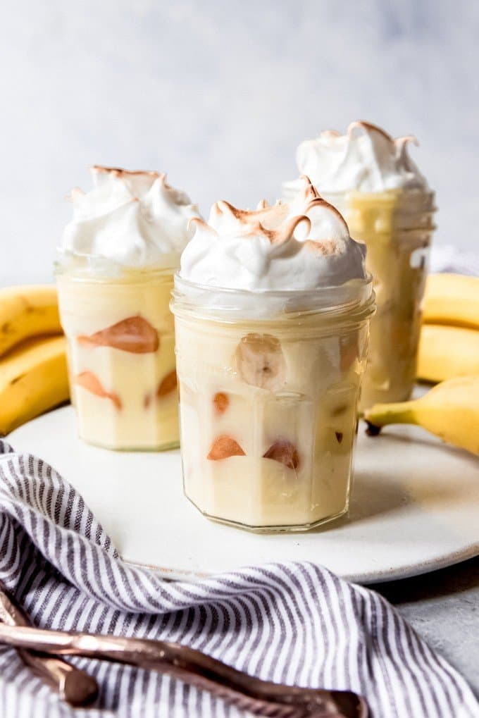 This Homemade Banana Pudding recipe is a classic Southern dessert made with layers of sliced fresh bananas, an easy homemade custard, Nilla wafers, and topped with a light and fluffy meringue! It's the perfect way to finish any Southern meal!