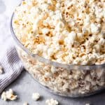 Learning how to make stovetop popcorn is so easy and fun! Stovetop popcorn is one of the cheapest munchable snacks that everybody loves and you can make it for your next movie night at home with just popcorn kernels, a good pot with a lid, oil, and salt!