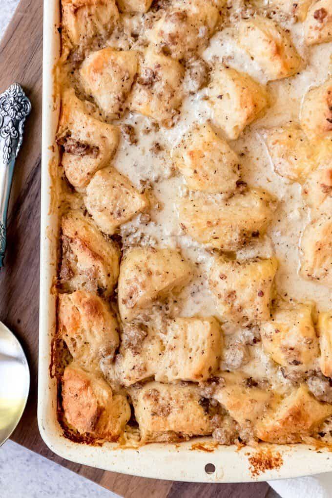 When it comes to breakfast casseroles, the savoriest and most delicious of them all just might be this Biscuits and Gravy Casserole.  Made with a homemade sausage gravy, eggs, just enough cheese, and of course, lots of soft biscuits, this easy breakfast casserole is perfect for large gatherings, lazy weekend breakfasts, and holiday brunch.