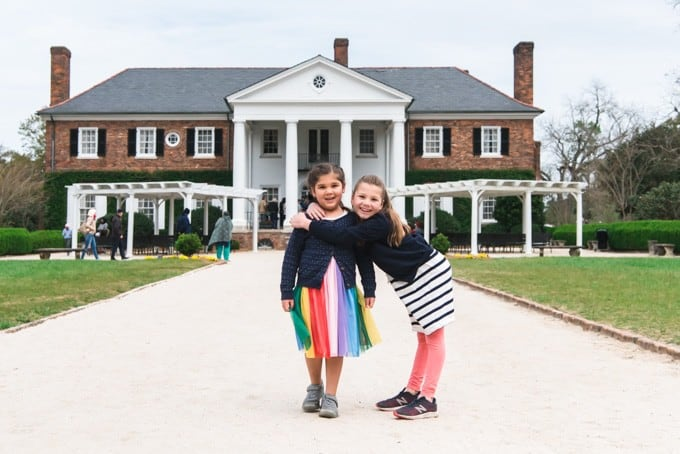 An image of sisters in front of the main house at Boone Hall Plantation.