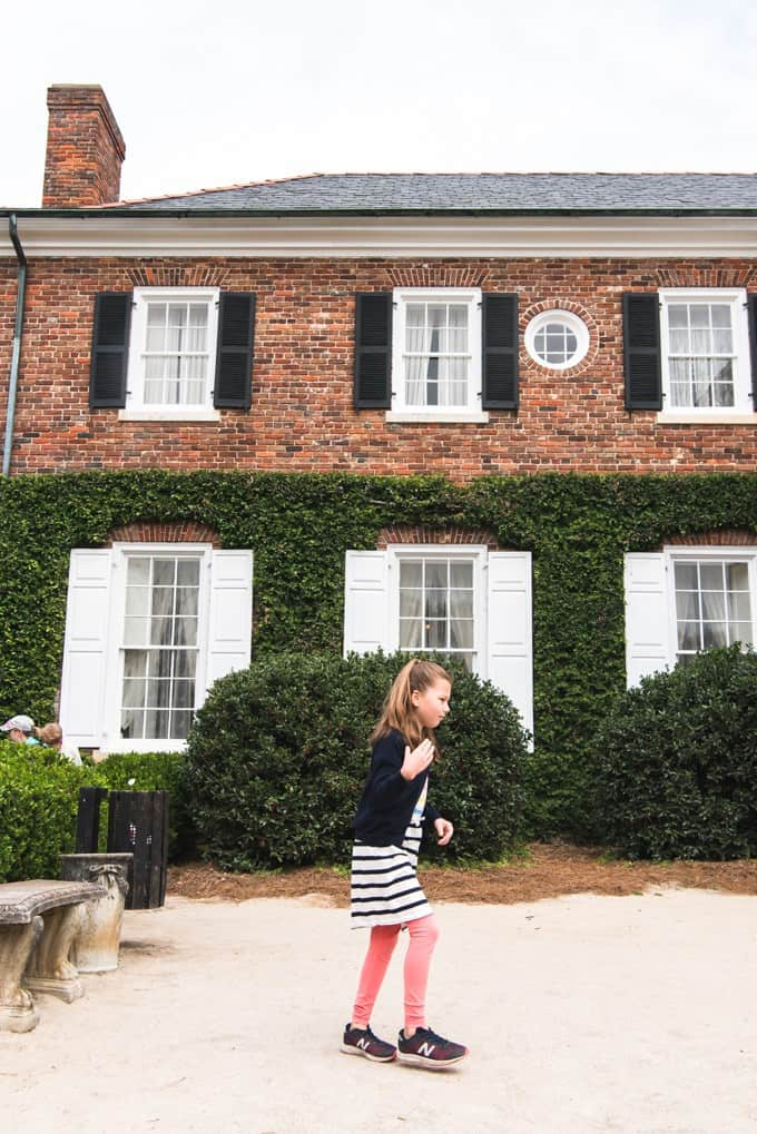 An image of a girl in front of the manor house at Boone Hall Plantation.
