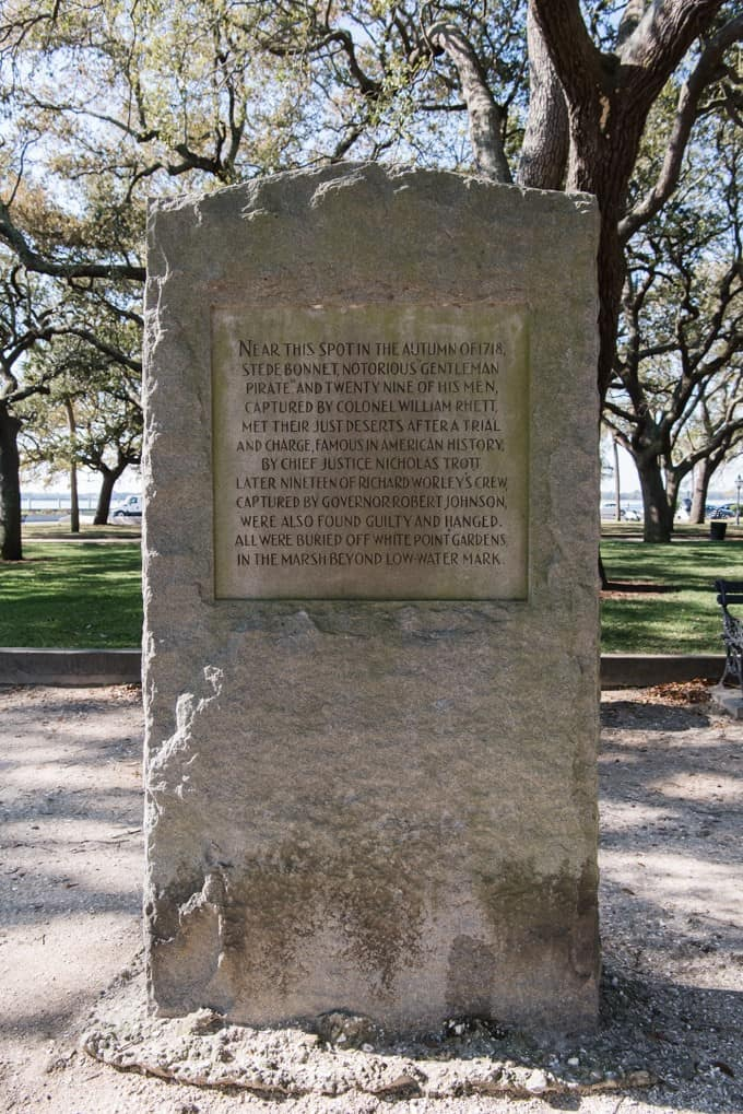 An image of a stone marker describing the hanging on pirates in Charleston, South Carolina.