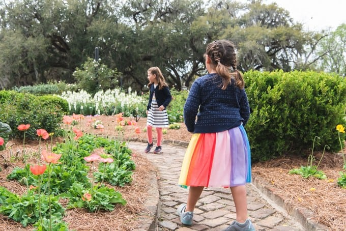 An image of two girls walking through the gardens at Boone Hall Plantation.