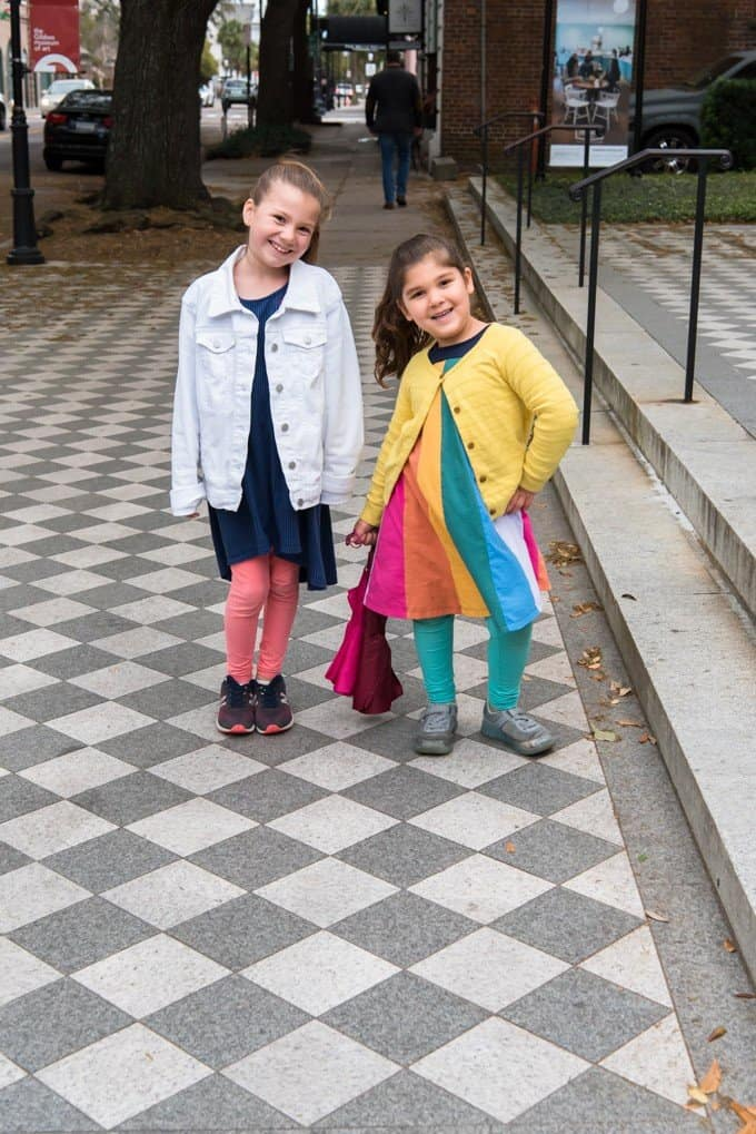 An image of two girls on the sidewalk in Charleston, South Carolina.