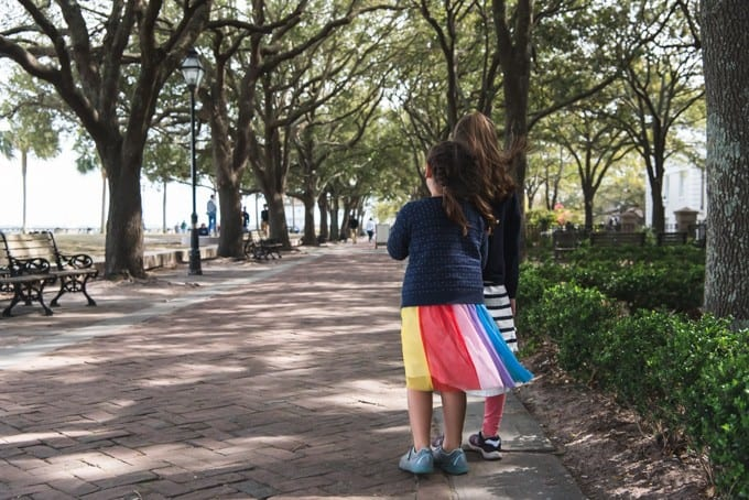 An image of two girls walking through a path in the park in Charleston, South Carolina.