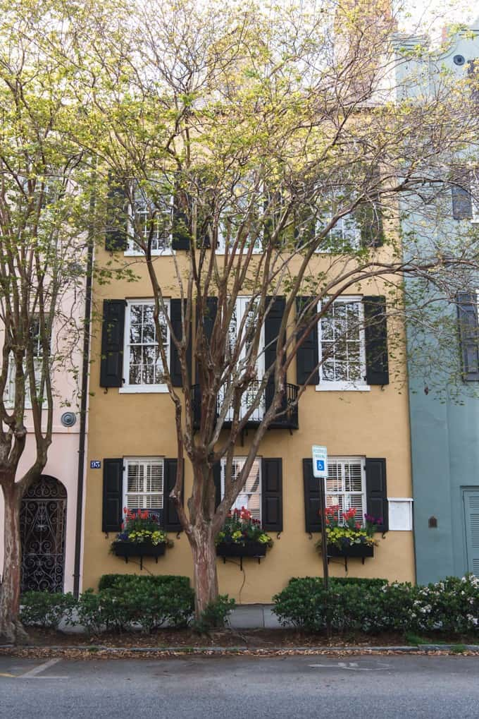 An image of a yellow house on Rainbow Row in Charleston, South Carolina.