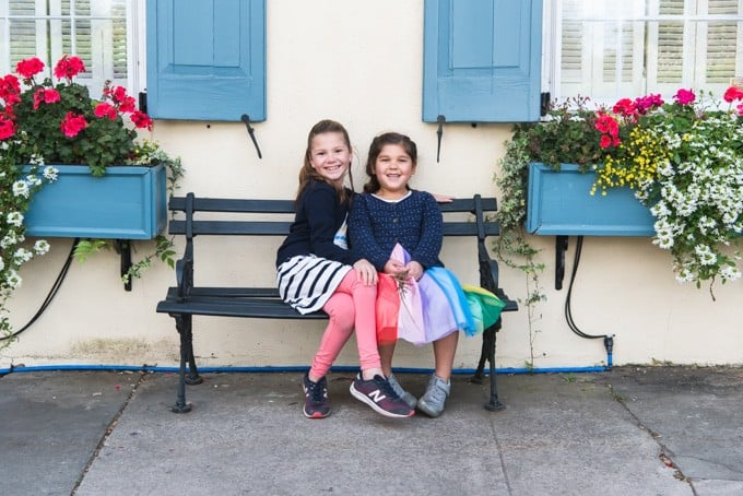 An image of two girls on a bench.