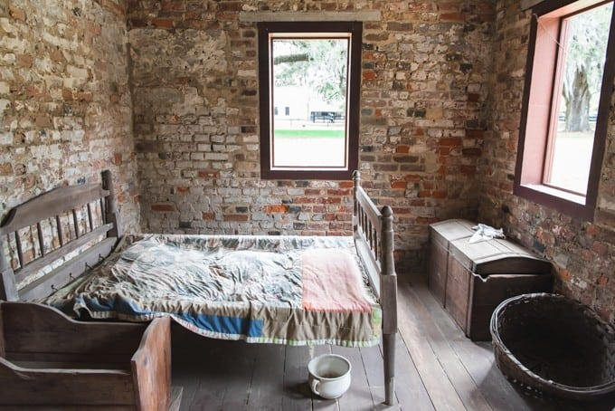 An image of a bed in a slave cabin at Boone Hall Plantation.