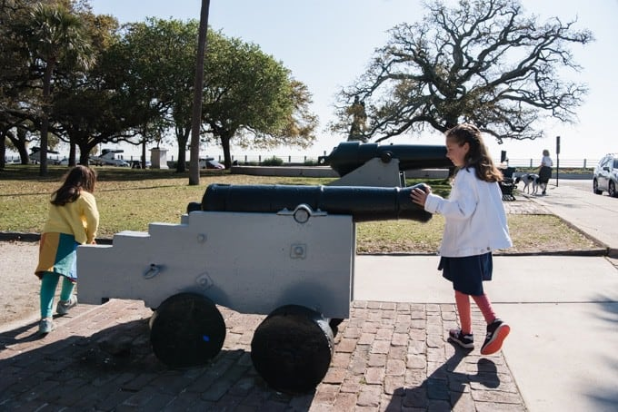 An image of kids playing with a cannon display in a park in Charleston, South Carolina.