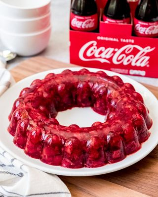 Coca-Cola Jello Salad is a jiggly, fruity treat studded with chopped tart cherries and crushed pineapple, with a bit of kick from the Coca-Cola.  It's especially fun made in a jello mold!