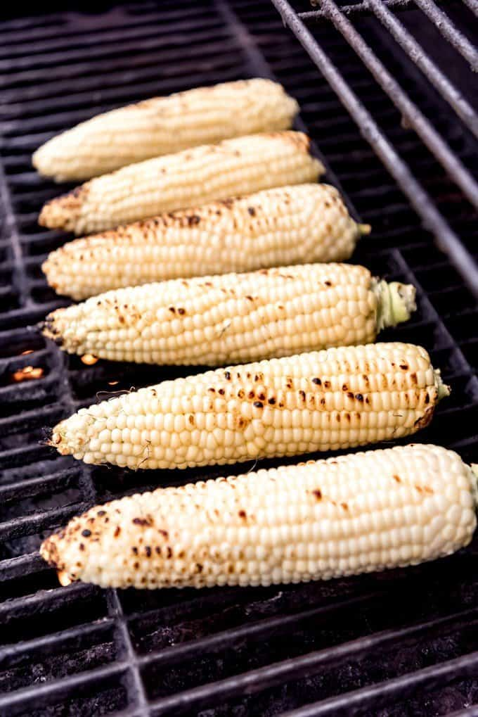 An image of corn on the cob on the grill.