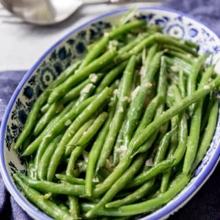 Tender-crisp Haricot Verts (French green beans) with Dijon Vinaigrette are a delicious and easy-fancy side dish that are perfect for serving alongside any holiday meal or Sunday supper.  They can be served warm or cold, making this a great option for picnics and summer barbecues!