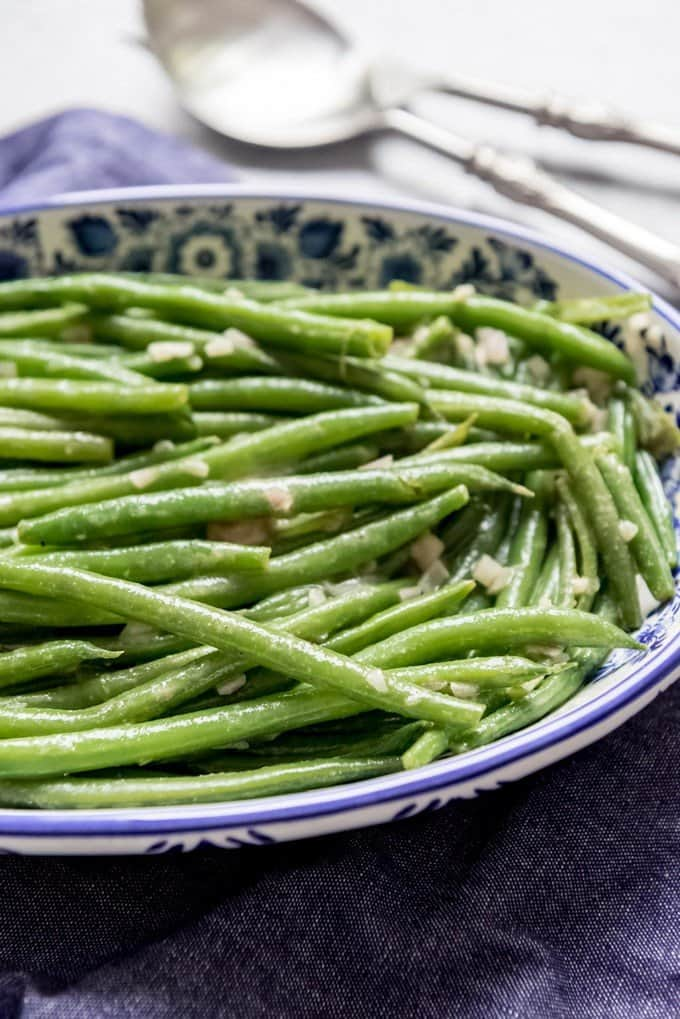 An image of a bowl of French green beans with dijon vinaigrette.
