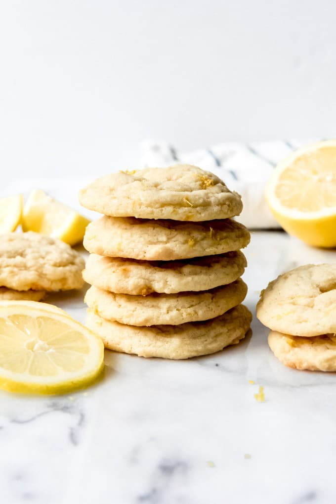 These soft, chewy Lemon Sugar Cookies are so light and sweet and lemony good!  If you love lemon desserts or cookies, you will adore these easy lemon cookies.